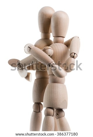 Two wooden figures are hugging, isolated on a white background.