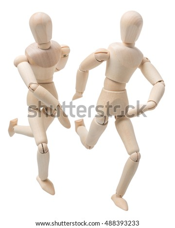 two wooden figures dummies mannequins running isolated on white background