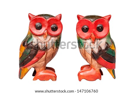 Two wooden owl. - stock photo