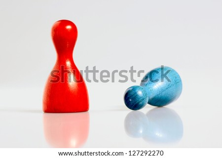 Two wooden playing figurines. - stock photo