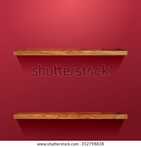 Two wooden shelves on a red wall.