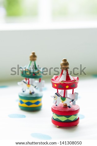 Two wooden toy carousel