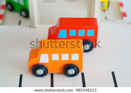 Two wooden toy cars