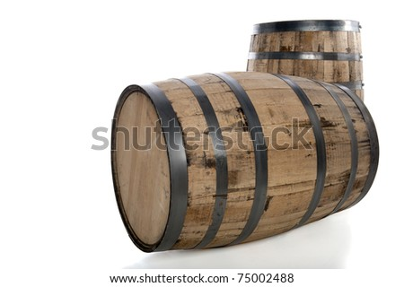 Two wooden whiskey barrels isolated on white - stock photo