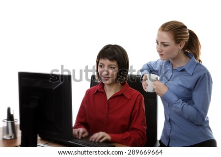 two work colleagues working together in the office - stock photo