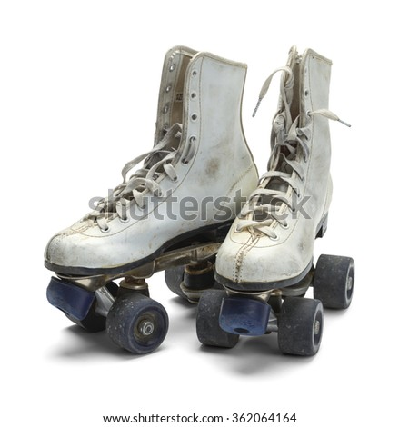 Two Worn Roller Skates Isolated on White Background.