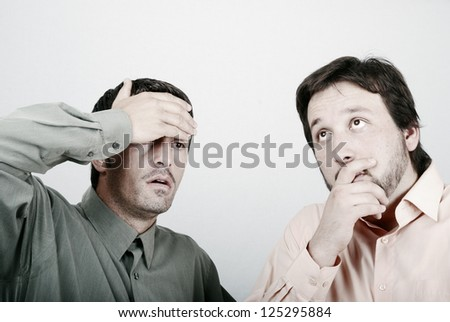 Two worried man in trouble crisis - stock photo