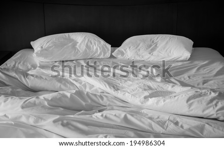 two wrinkle pillow on bed in black and white color - stock photo