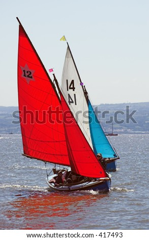 Two yachts engaged in a race - stock photo