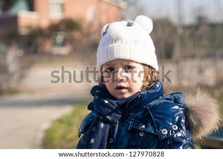 Two year little girl winter park portrait. - stock photo