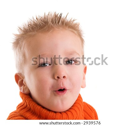 Two year old boy with a funny face