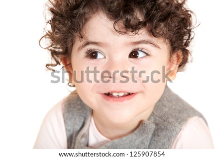 Two year old girl with curly hair portrait, studio shot. - stock photo