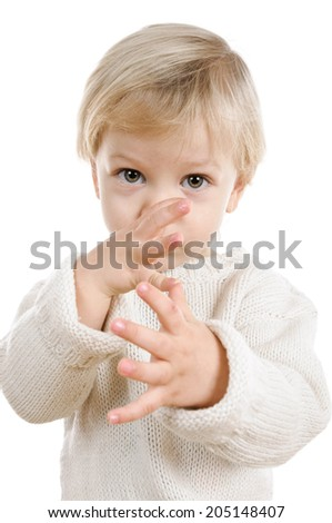 two years old blond boy in white sweater on white background