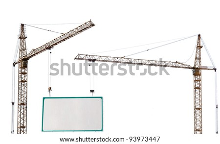 two yellow hoisting cranes and advertisement hoarding isolate on white background - stock photo