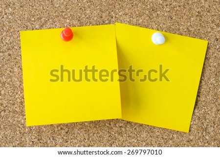 two yellow note and color shot of a brown cork board