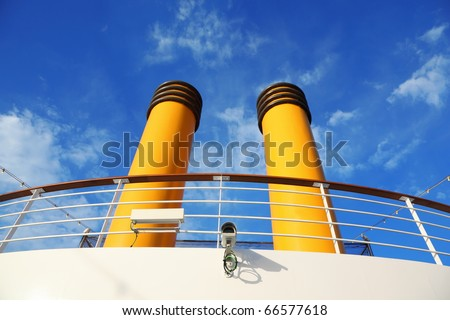 two yellow pipes on big cruise ship. camera and wires. lamps. - stock photo