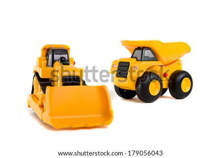Two yellow toy construction vehicles on white background