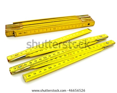 Two yellow wooden meters over the white background - stock photo
