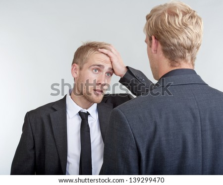 two you businessmen standing, discussing, arguing - isolated on light gray - stock photo