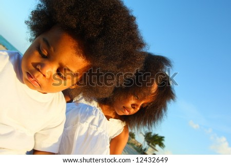 Two young African American children outside - stock photo
