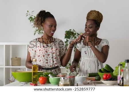 Two Young African Women Cooking. Healthy Food - Vegetable Salad. Diet. Dieting Concept. Healthy Lifestyle. Cooking At Home. Prepare Food