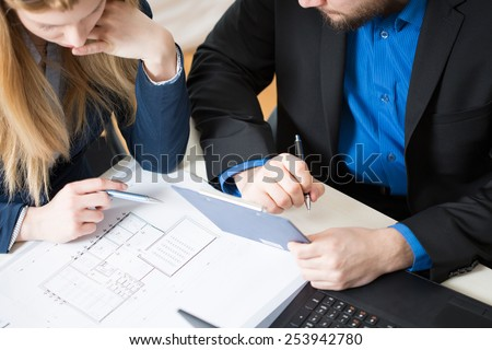Two young architects thinking about new building project - stock photo