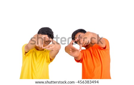 Two young asian man make heart symbol by their hands isolated - stock photo