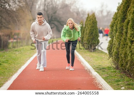 Two young athletes ready to start running - stock photo