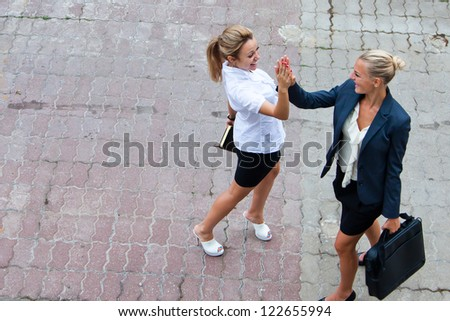 Two young, attractive and happy business woman - stock photo