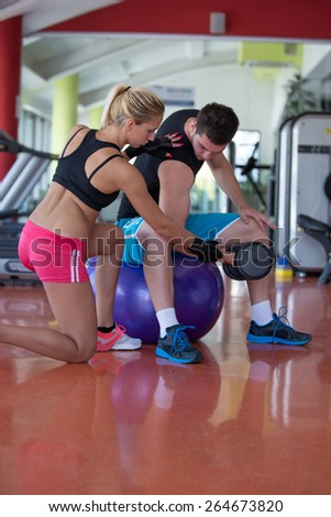 two young attractive people practicing together in the gym