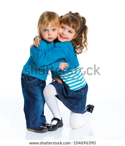 Two young beautiful sisters.  Isolated over white background.