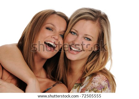 Two Young beautiful Sisters smiling isolated on a white background - stock photo