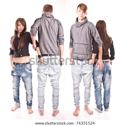 Two young beautiful twin couples posing on white background