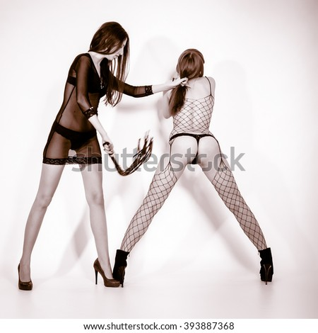 Two young, beautiful woman, bdsm - stock photo