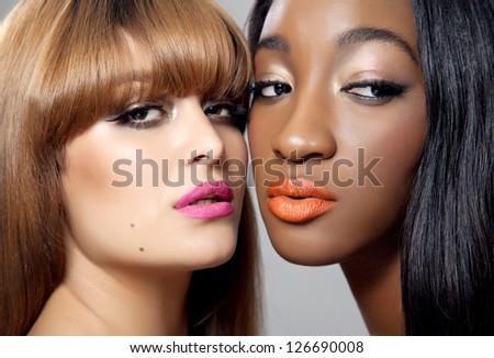 Two young beautiful women with perfect skin - stock photo