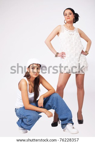 Two Young beauty girls posing in hip-hop style - stock photo