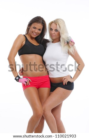 Two young beauty posing in trainer clothes