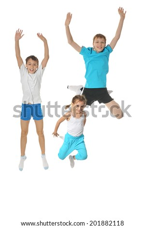 Two young boys brothers and little sister exercising isolated on white background