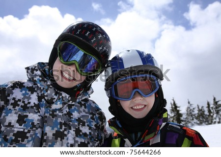 two young boys in skiing outfit