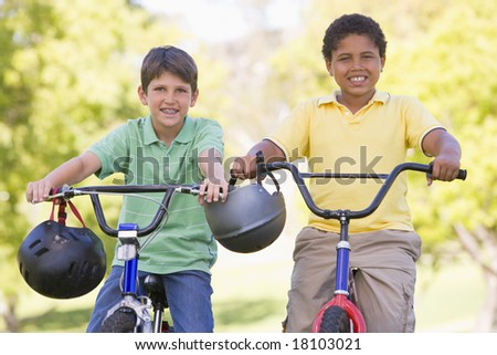 Two young boys on bikes