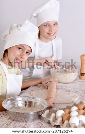 Two young boys preparing dinner in the kitchen