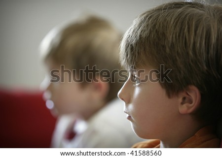 two young boys watching television - stock photo