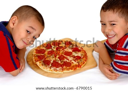 Two young brothers ready to eat a pepperoni pizza