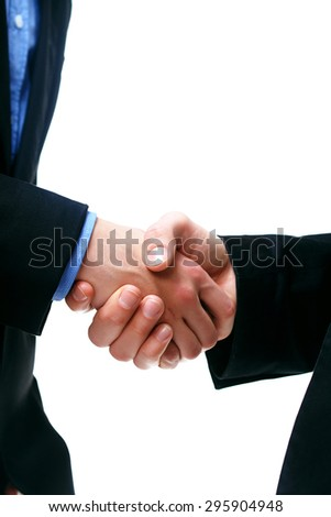 two young business executives shaking hands close-up