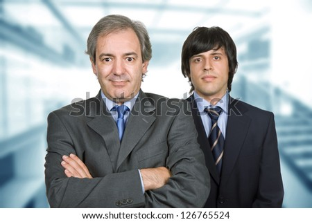two young business men at the office, focus on the left man