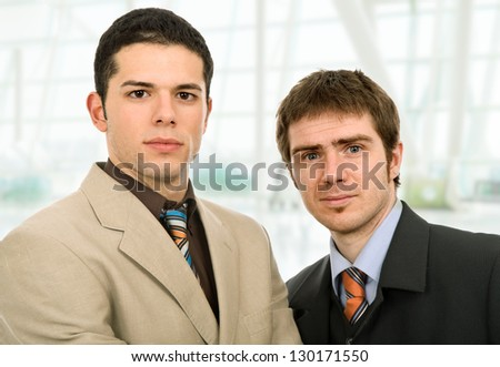 two young business men portrait at the office - stock photo