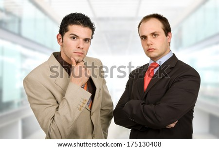two young business men portrait at the office