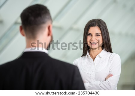 Two young business people at work in modern office. - stock photo