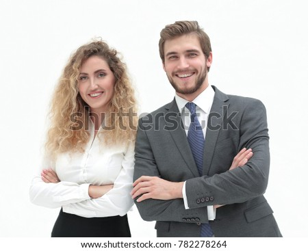 two young business people stand with arms folded