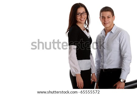 Two young business people working, isolated on white (room for text at left) - stock photo